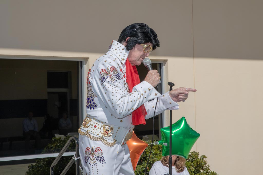 Elvis impersonator performs and sings
