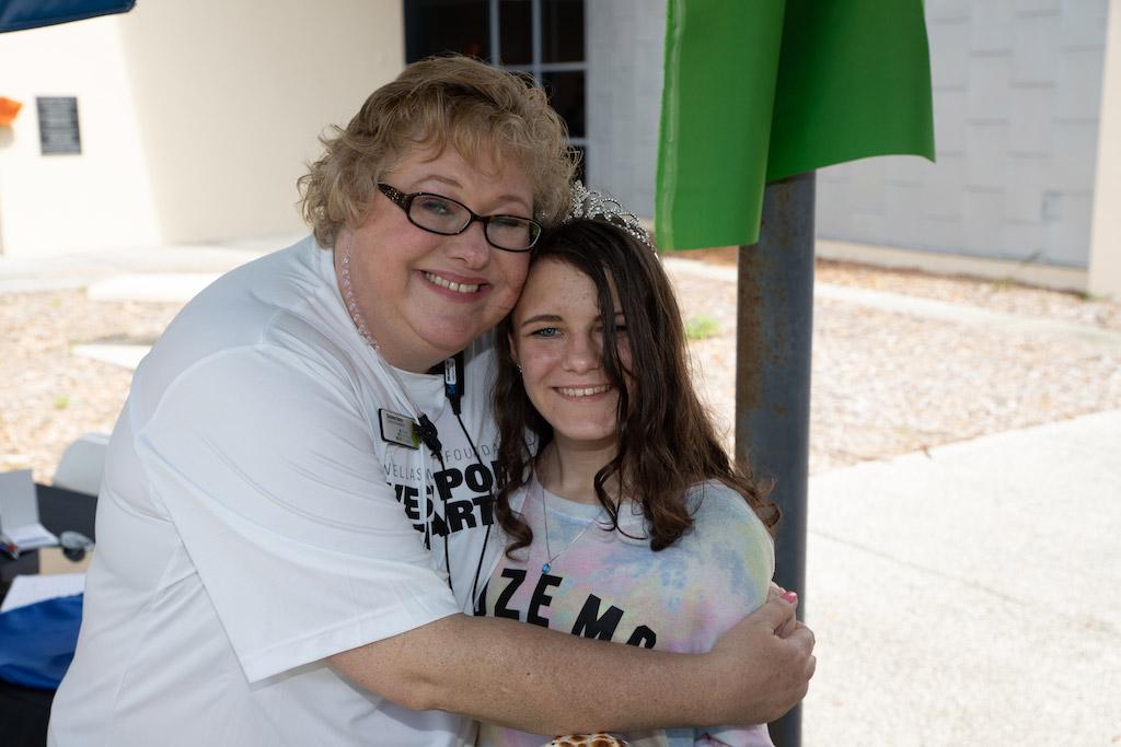 Woman and girl hugging