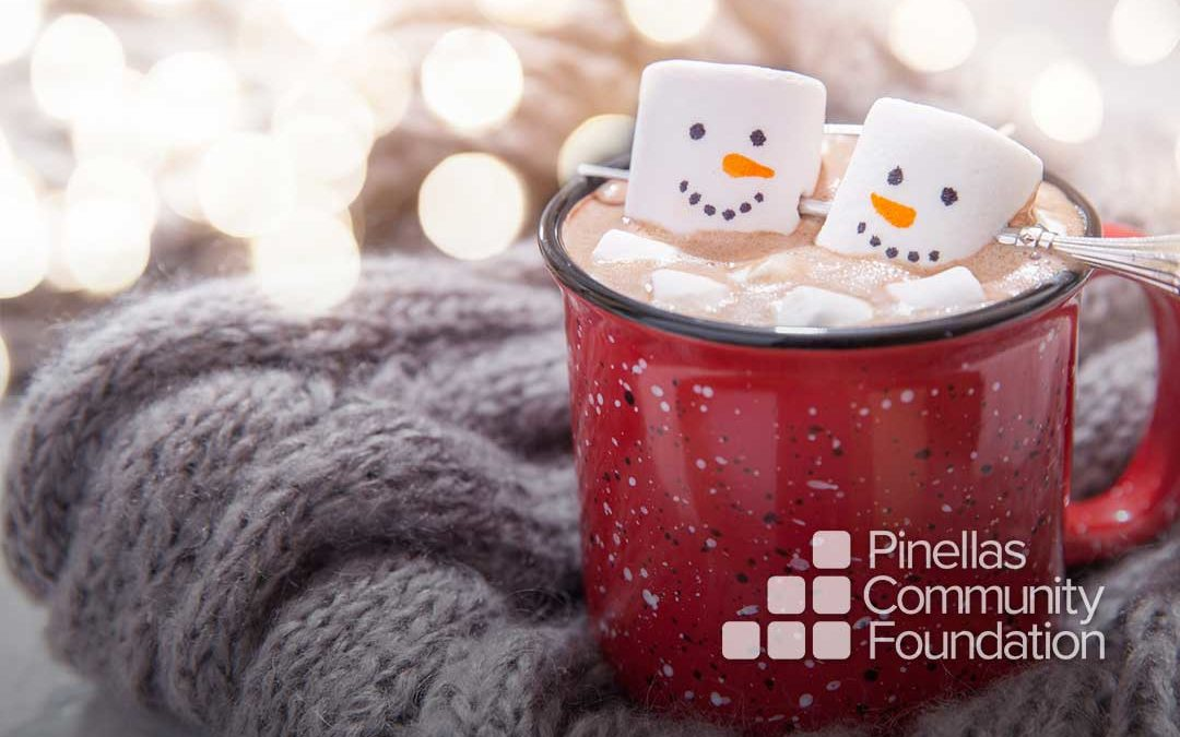 Two marshmallows avoid lonely holidays together in a cup of cocoa.
