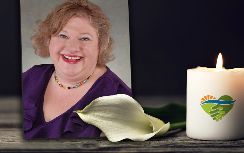 Suzanne Ruley photo with calla lily and candle