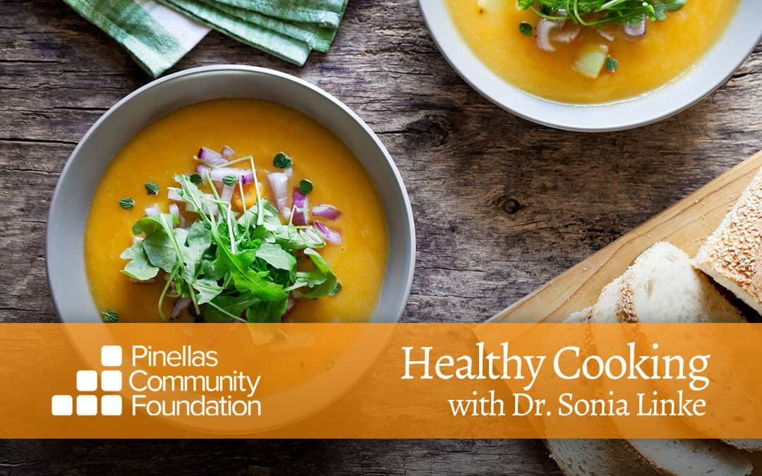 Yellow squash soup topped with baby greens and diced red onions to warm up the winter.